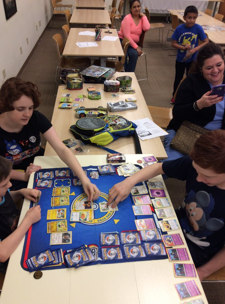 Kids battling out in Pokemon the Trading Card Game.