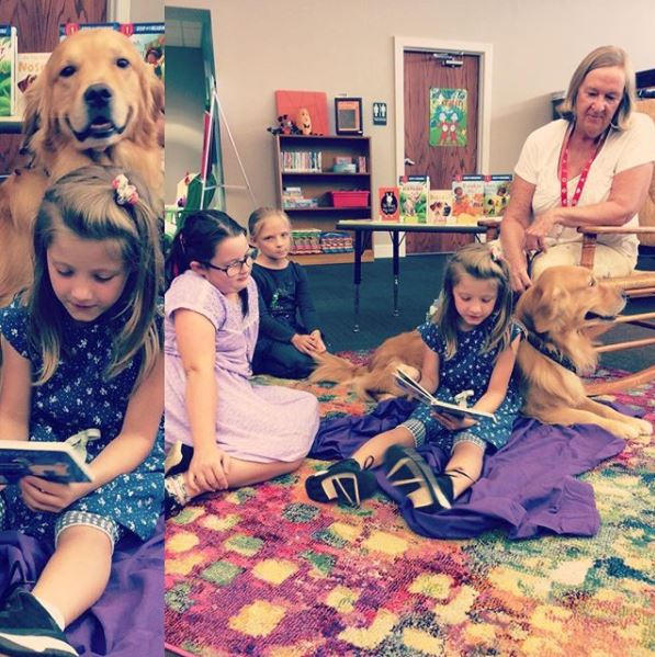 Carl, the therapy dog, and friends reading together.