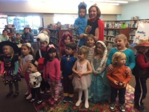 Kids in costumes with Ms. Elizabeth.