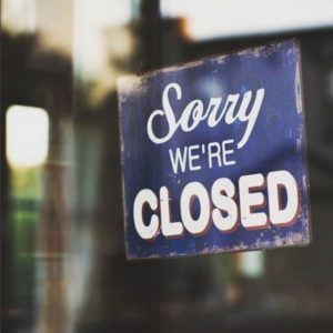 Sorry we're closed sign.