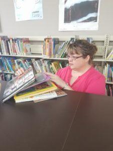 Staff member sorting books.
