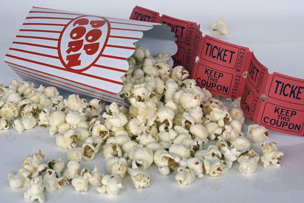 Popcorn and movie tickets.