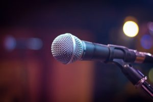 A microphone with a blurry background.