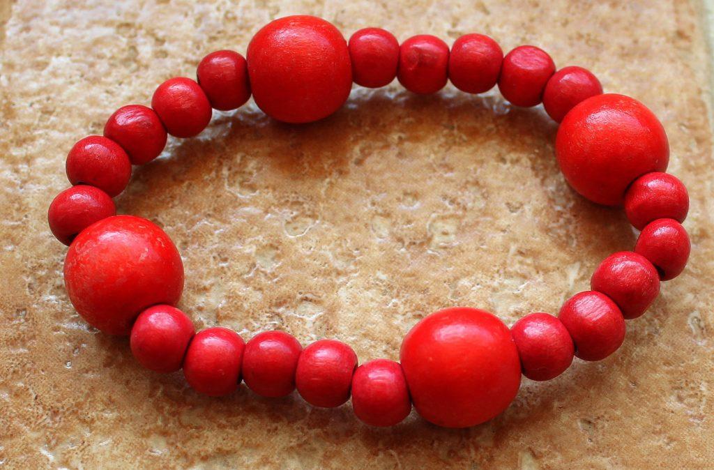 Bright red beaded bracelet.