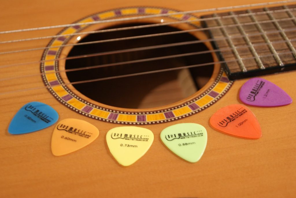 Guitar picks on a guitar.