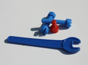 Plastic wrench and screws.