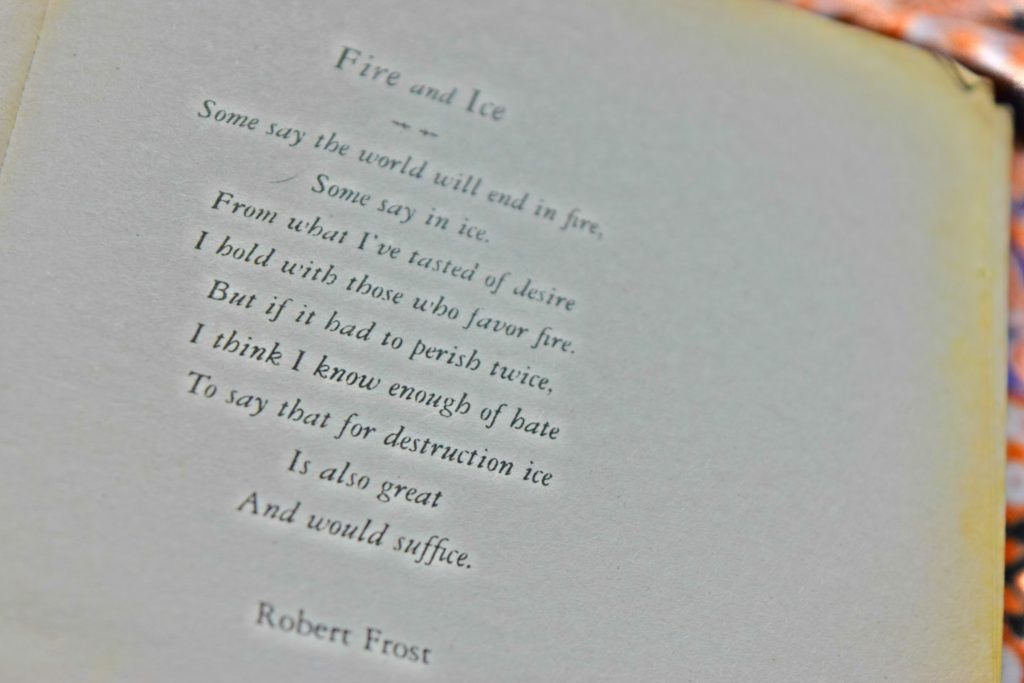 Blurred image of Fire and Ice poem by Robert Frost.