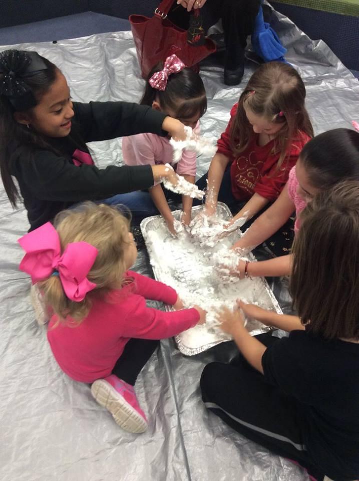 Kids playing in manmade snow.