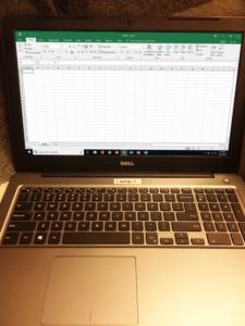 Laptop running Microsoft Excel 2016.