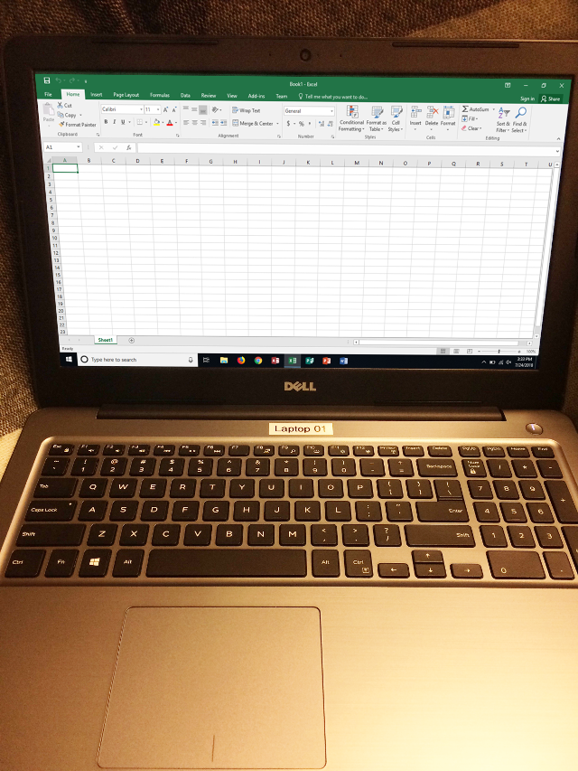 Laptop running Microsoft Excel 2016.