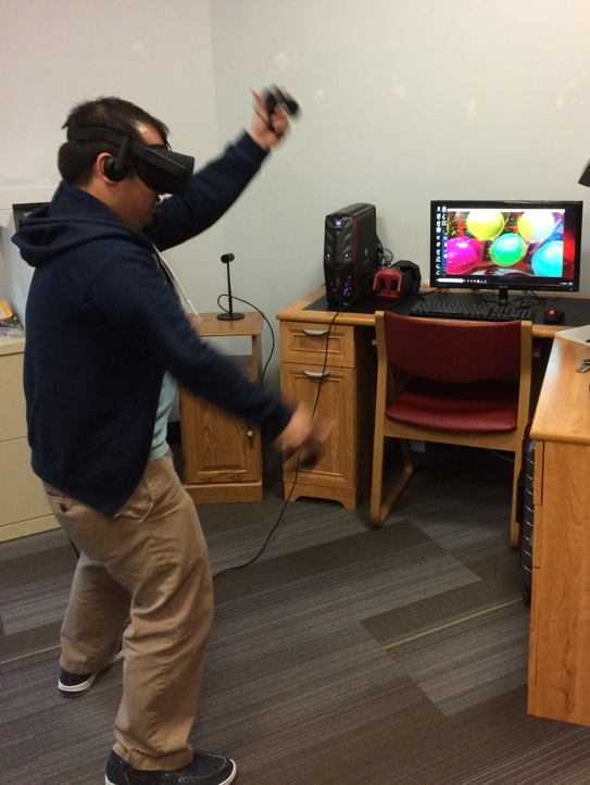 A person playing with virtual reality.