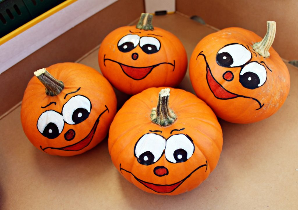 Pumpkins with silly expressions.