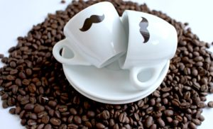 Coffee mugs with mustaches and coffee beans.