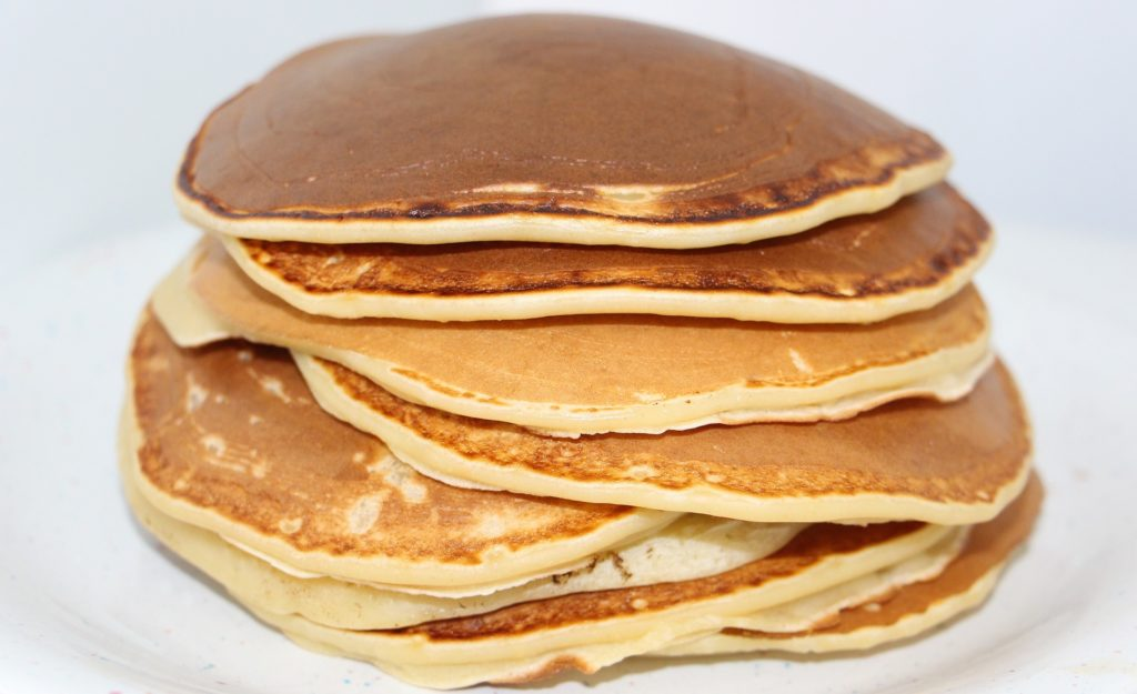 A stack of golden-brown pancakes.