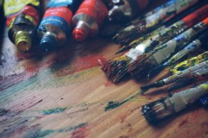 Paint-covered paintbrushes
