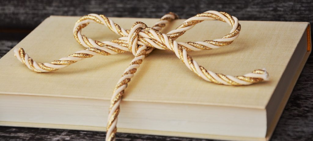 Book with golden cord wrapped around it.