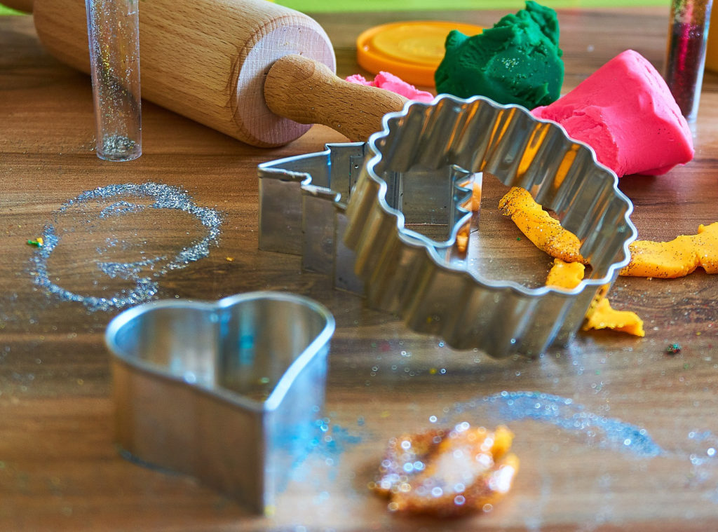 Cookie cutters, rolling pin, glitter, and homemade play dough