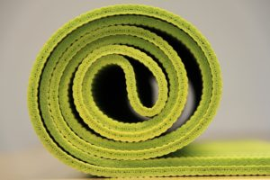Bright green yoga mat.