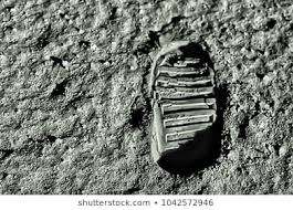Photo of an astronaut's footprint on the moon.
