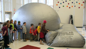 Children entering a mobile planetarium.