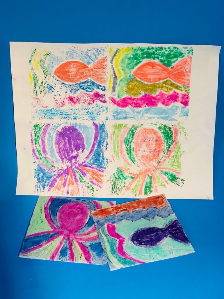 Brightly colored ocean animal shapes printed onto paper with styrofoam stamps.